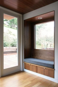 Combination window seat and bench by the entry. Another good idea.