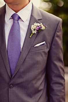 Groom's attire - gray suit with purple tie!....ohhh where' did they get the tie??? these are our colors and that tie would be perfect!!!!