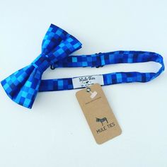 Fall in love with our blue pixelated bow tie. This tie is perfect for any events casual or formal parties. Very flattering sleek bow tie that makes you feel confident. The pixelated print guarantees endless compliments each time your wear it. This lightweight polyester fabric neckwear embraces artistic design and uniqueness! With its deep blue color so vibrant everyone will wonder where you got your tie! Crazy stylish with a classy style. The different shades of blue combination pops up even…