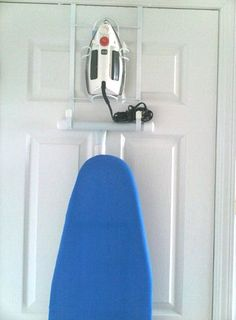 Keep your iron and ironing board out of the way: hang it on the back of a door from @downshiftingpos blog