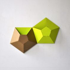 Recycled cardboard wall pockets. Would be cool to do to whole wall.