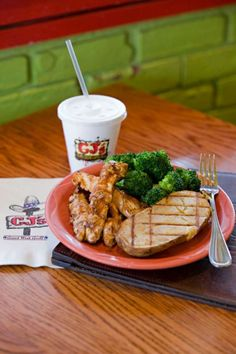 CJ's grilled chicken tenders with BBQ Sauce, baked potato, broccoli and low fat milk. Request sauce on the side.