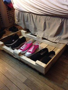 Reclaimed pallet under bed storage for 6 dollars!! Removed bottom slats, added casters, and a handle and flipped it over.