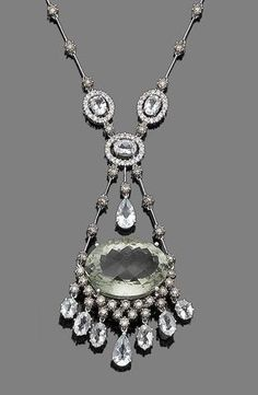 A green quartz, aquamarine and diamond pendant necklace.