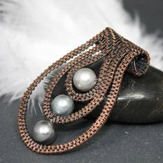 This lovely, bold pendant is a perfect accessory for those that appreciate big, brave and unique designs. It is an ideal jewelry piece to be given as a present for those around you that love things handmade with care and joy. The pendant was made using wire wrapping and wire weaving