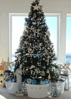 by the seashore Christmas tree...I have done a nautical tree..I used sand dollars, starfish, clam & scallop shells, etc..fish, (puffer fish look great) I used clear round balls of different sizes ( look like bubbles) & then use fish net or jute for a wrap around look..