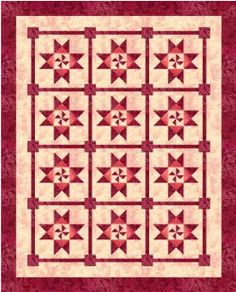 Catch a Spinning Star Bed #Quilt by Judy Laquidara from Patchwork Times