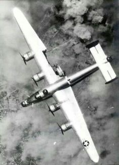 A B-24 in trouble. Looks like a flak blew his right flap off but managed to make it through