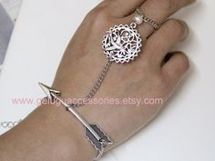 The Hunger Games Inspired Silver Mockingjay, Arrow, Peeta's Pearl adjustable ring and bracelets  etsy.com $7.99