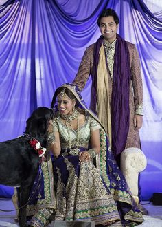 A black lab doggy joins the Indian newlyweds to celebrate!