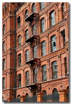 This photo from Lodzkie, West is titled 'Manufaktura'. Visit Poland, Monuments, Brick In The Wall, Classic Building, Poland Travel, Fire Escape, Industrial Architecture, Old Factory, Old Bricks