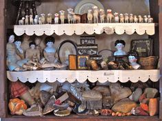 Nicol's gorgeous collections old of Putz sheep, china dolls and pin cushions