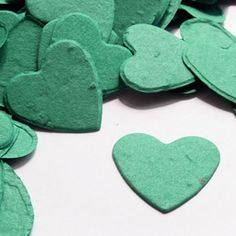 Perfect plantable seed confetti for an eco-friendly wedding. When thrown outside the heart shaped plantable seed confetti will grow into wildflowers. It's eco-friendly, fun and so memorable! Awesome idea for decorating tables and letting people take home! Um YES.