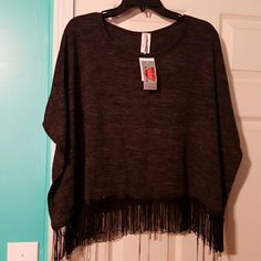 Discreet Top size xl NWT Discreet Top size xl  NWT  fringe at bottom has arm holes kinda like a boho cover blackish Gray discreet  Tops Tunics