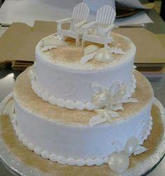 Simple 2-tier beach themed wedding cake with brown sugar sand and white chocolate seashells