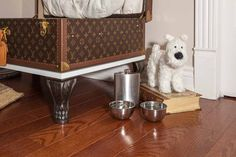 The trousseau has been raised on lion feet so that I can look out the window. There is my flask and travel bowls. http://montecristotravels.com/a-travel-dogs-room-revealed/