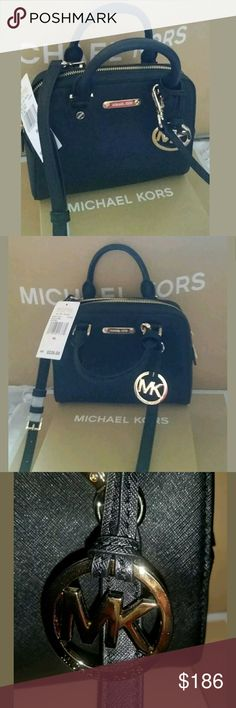 "$230 Michael Kors Black Saffiano Mini Crossbody INCLUDES THE MICHAEL KORS MK GOLD PURSE CHARM $40 Value  Added value of $40/$50.00  Color:Black  Style: Black Saffiano Crossbody Purse  Saffiano leather; lining: polyester  Top-7'';Bottom-8'' x 6""H x 3.5""D  Interior features logo-print lining, 1 zipped pocket  Double top handles with 3.4""drop;23""-26""adjustable crossbody strap  Zip closure  Exterior features back slip pocket, gold-tone hardware  Imported  Keep your look classic and sophisticated…"