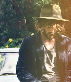 Hat with long hair goes best with a casual sports jacket — Men's Fashion Blog - #TheUnstitchd