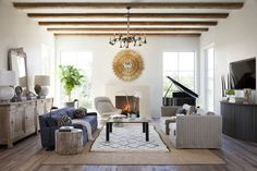 Rustic-Meets-Modern Texas Home ... love the Moroccan rug and gold sunburst mirror.