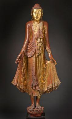 Mandalay, Myanmar. Theravada Buddhism Shakyamuni, wood, lacquer, gold and glass, 20th C.