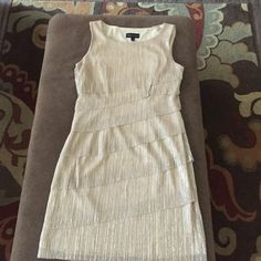 Cocktail dress Connected Apparel Brand. Size 10. Knee Length. Champagne and Gold shimmer and Straps are 2 Inches wide. Connected Apparel Dresses Midi