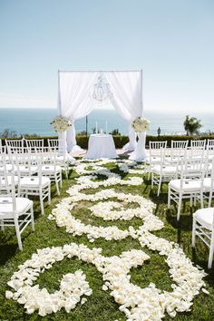 Photo Credit: Luxury Estate Weddings and Events Why We Love It We love the romantic feel of this all-white ceremony décor!