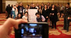 Arab Bloggers Meeting participants hold a sign calling for the release of jailed colleagues.