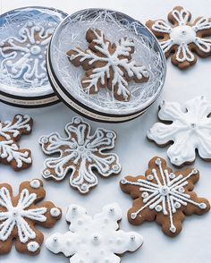 """Set a snowy scene on your favor table with these gingerbread cookies. Gift them in clear acetate containers banded with ribbon printed with a sentimental saying (ours reads, """"A love like no other"""")."""