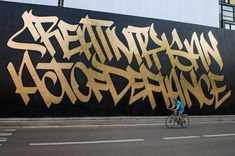 """""""Creativity is an Act of Defiance"""" on the facade of Urban Nation museum for…"""