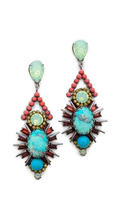 Elizabeth Cole Turquoise Drop Earrings. Drop-cut crystals anchor dangling sunburst settings centered with turquoise cabochon stones.
