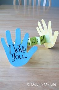 I am thinking of making a card like this with all of the kids handprints outlined and color coded by their favorite colors, one on top of the other.  We love you........THIS MUCH!