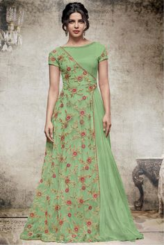 This Exclusive Gown Is An Ultimate Wedding Wear Collection With The Mesmerizing Colours Of Green . With The Artistic Embroidery,Lace Work,Zari Work And Leave No Stone Unturned And Be At Your Fashion. Source by yayuksamgres dresses indian Indian Designer Outfits, Indian Outfits, Designer Dresses, Indian Clothes, Green Wedding Guest Dresses, Trendy Dresses, Fashion Dresses, Long Gown Dress, Long Gowns