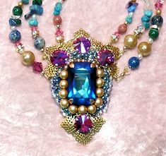 """This one has it all!  Bead embroidery, filigree work, stranding and big beautiful Swarovski jewels in a stand-out-and-be-noticed necklace!  I call it """"Royalty""""."""