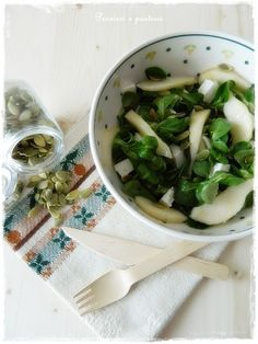 soncino salad with pears, cheese and pumpkin seeds