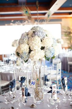 Hydrangea and peacock centerpiece - See more vow renewal ideas at IDoStill.com