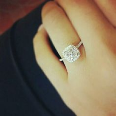 this stunning cushion-cut diamond engagement ring. Probably my favorite so far.
