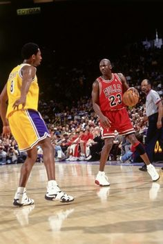 Michael Jordan of the Chicago Bulls dribbles against Kobe Bryant of the Los  Angeles Lakers on February 1998 at The Forum in Inglewood b05bacc0af