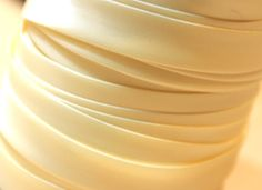 Google Image Result for http://www.crystal-clover.com/images/ProductImages/Accessories/Satin-Bias-Binding/ivory.JPG