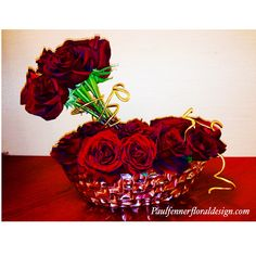 Valentine's Day Collection 2015. 2 dozen Black Magic roses in a silver ceramic boat. Simple and elegant. #paulfennerfloraldesign #valentineflowers #flowers #flowerstagram