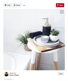Product: White stool. Use as: Bathroom side table.
