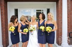 navy and yellow wedding - I love how all the bridesmaids are in different style dresses but same color! Everyone gets the dress that is most flattering on them but it stays cohesive.