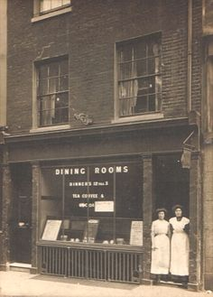 'Dining Rooms' with two waitresses standing in the doorway Brentford High Street Late Victorian. Vintage London, Old London, West London, Victorian Street, Victorian Era, Local History, Family History, Old Photos, Vintage Photos