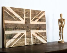 Modest and simple display of Union Jack. Made out of palette wood. Not painted to keep the beauty of wood visible. Rustic style display of British pride. Size 27.5 inches by 13.2 inches or 70 cm by 35 cm. FREE WORLDWIDE SHIPPING. Air delivery from Ukraine by registered mail