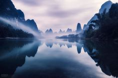 Perched high atop the city of Guilin, China, photographer Kyon.J had an extraoridnary view of the Li River as it winds through an unusually steep mountainscape. Early in the morning the area is often filled with fog or haze trapped in the mountains, certainly a dream scenario for any landscape p