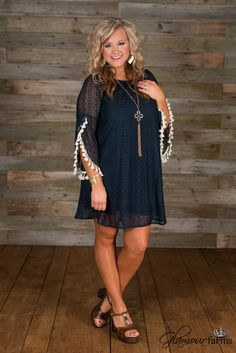 Forever In Blue Lace Tunic/Dress is boho glam! Featuring a round elasticized neckline, to wear on or off the shoulder and long bell sleeves with a fly-away and tassel detail at cuff.