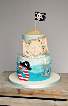 "This is the cake for my gorgeous Nephew's Birthday. He had a pirate themed party, so a pirate cake it had to be! A wavy sea with a sugar ""Pirate"" no. sugar anchor and pirate map with the skull and crossbones flag blowing in the wind! Fancy Cakes, Cute Cakes, Pirate Birthday Cake, Pirate Cakes, 3rd Birthday, Birthday Ideas, Birthday Cakes For Kids, Beautiful Cakes, Amazing Cakes"