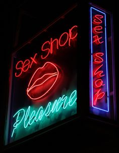 Neon sign for sex shop. Mouth custom sign. Illumination.
