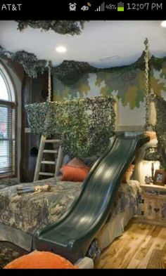 """I love this for a little boy's room. Except no slide maybe just fill in the rest of the """"deer stand"""" so it can be used for a reading nook or secret play area."""