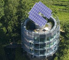 Heliotrope Solar Home in Germany by Architect Ralph Disch. Rotating, it takes full advantage of the sun, allowing daylight to course though its triple-pane windows and energize its large roof-mounted solar array and solar thermal pipes. The result is one of the first zero-energy modern homes in the world — generating five times the energy it uses