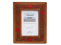 $44 A beautiful 4x6 leather picture frame embossed with hearts that are painted red. It's gorgeous and will make an excellent anniversary frame!